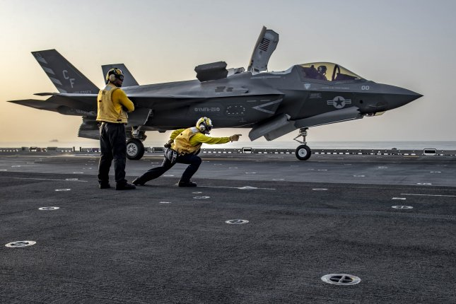 Aviation Boatswain's Mate 1st Class Francis Centeno launches an F-35B Lightning II attached to the Avengers of Marine Fighter Attack Squadron 211 from the flight deck of Wasp-class amphibious assault ship USS Essex. Photo by Mass Communication Specialist Seaman Sabyn L. Marrs/U.S. Navy