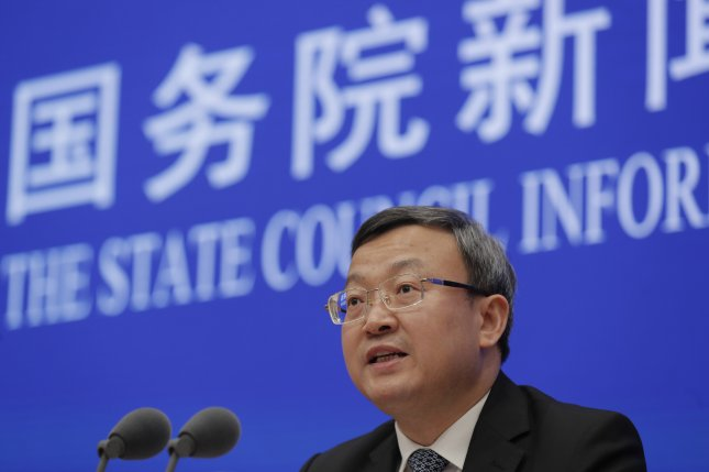 Wang Shouwen, China's vice minister of commerce, speaks during a news conference Sunday in Beijing on the release of a white paper on the Asian nation's position on the China-U.S. economic and trade consultations. Photo by Wu Hong/EPA