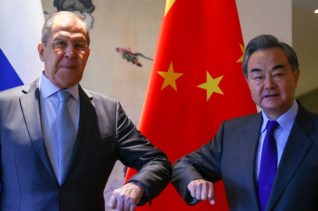 Russian Foreign Minister Sergey Lavrov (L) and Chinese counterpart Wang Yi (R) issued a joint statement Tuesday in Guilin, China, saying that the domestic affairs of Beijing and Moscow should not be of outside concern.Photo by Russian Foreign Affairs Ministry/EPA-EFE