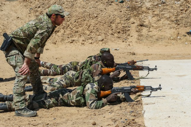 A U.S. Army Special Forces weapons sergeant observes a Niger army soldier during marksmanship training as part of Exercise Flintlock 2017 in Diffa, Niger, on Feb. 28. File Photo by Sgt. 1st Class Christopher Klutts/U.S. Army