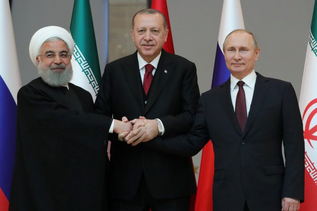 Turkish President Recep Tayyip Erdogan (C), Russian President Vladimir Putin (R) and Iranian President Hassan Rouhani are seen at a meeting in Ankara, Turkey, in 2018. The trio met in the Turkish capital again Monday. File Photo by Mikhail Klimentyev/EPA-EFE
