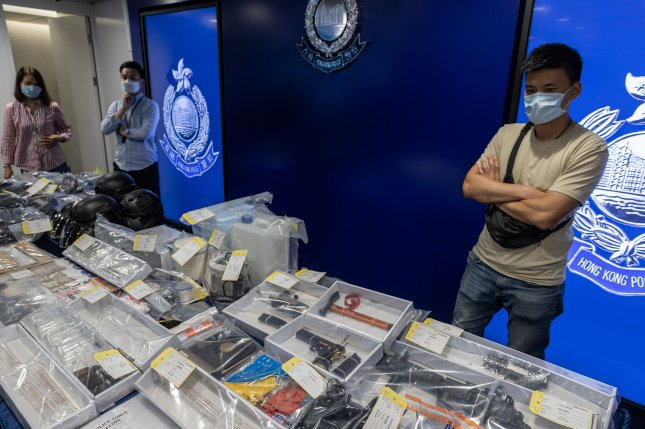 Hong Kong police arrest 9 in plot to bomb courts, train stations