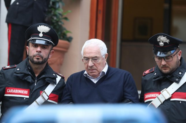 Settimo Mineo, considered the successor to Sicilian Mafia boss Toto Riina, is escorted by Italian Carabinieri officers after his arrest in Palermo, Sicily, Italy, on Tuesday. Photo by Igor Petyx/EPA-EFE