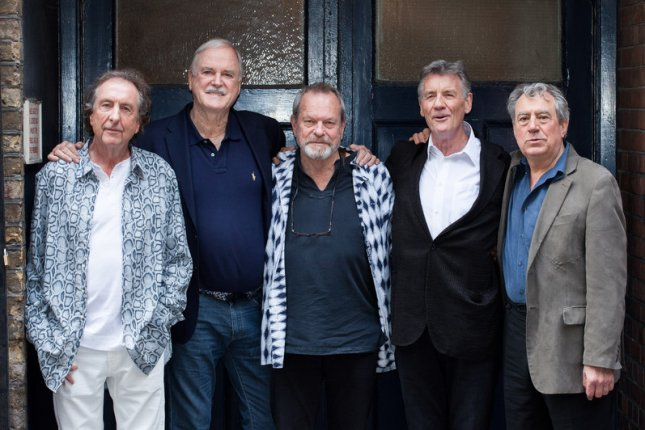 British comedy troupe Monty Python members, left to right,  Eric Idle, John Cleese, Terry Gilliam, Michael Palin and Terry Jones posing for a photograph during a media event in London in 2014. Jones' death at age 77 was announced on Wednesday. Photo by Daniel Leal-Olivas/EPA