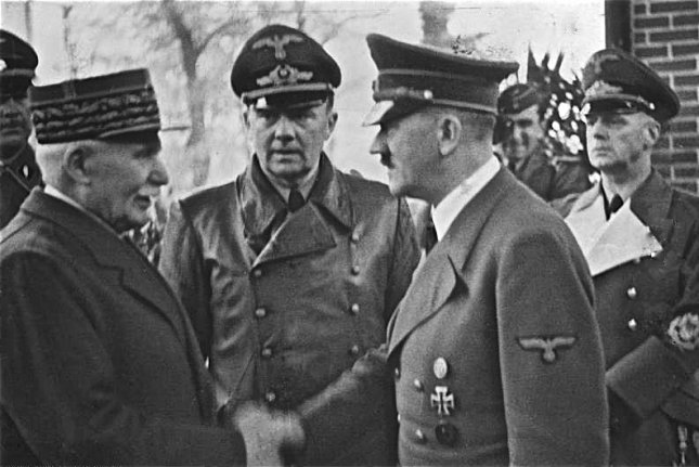 Vichy, France, Marshal Philippe Petain (L) greets Nazi leader Adolf Hitler in 1940. On November 10, 1942, Nazi troops entered previously unoccupied France, the de facto government of which was centered in Vichy state. Vichy was seen as a puppet government controlled by Germany. File Photo courtesy the German Federal Archive