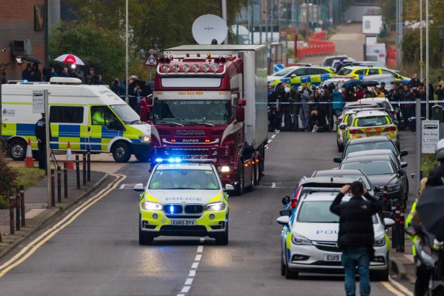 Police drive away the truck that had contained the bodies of 39 people, in Essex, Britain, on October 23. File Photo by Vickie Flores/EPA-EFE
