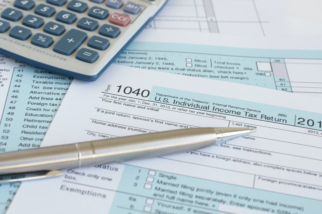 Changes to the U.S. tax code drastically cut refunds to taxpayers this year, and another change next year may do the same. File Photo by D. Pimborough/Shutterstock