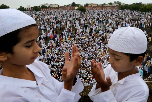 Hundreds of Muslims pray Monday in Bhopal, India, following the holy Eid celebrations. Photo by Sanjeev Gupta/EPA-EFE