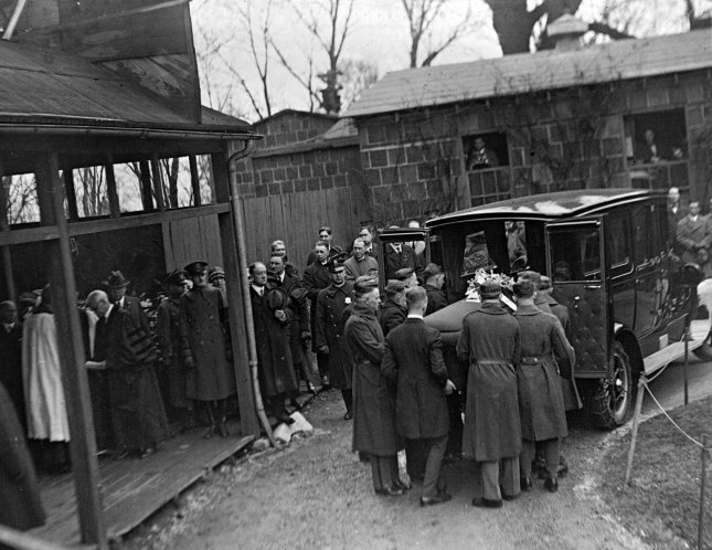 Pallbearers remove the casket of former President Woodrow Wilson from a hearse upon arrival at Washington National Cathedral in Washington, D.C., on February 6, 1924. File Photo by Library of Congress/UPI