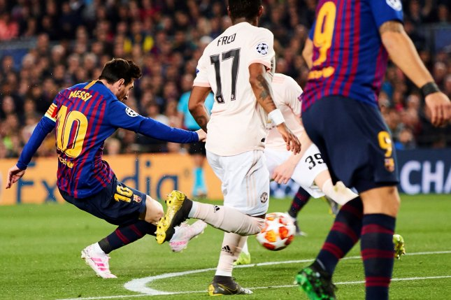FC Barcelona's forward Leo Messi (L) scores during a UEFA Champions League quarter-final second leg match between FC Barcelona and Manchester United on Tuesday at Camp Nou stadium in Barcelona. Photo by Alejandro Garcia/EPA-EFE