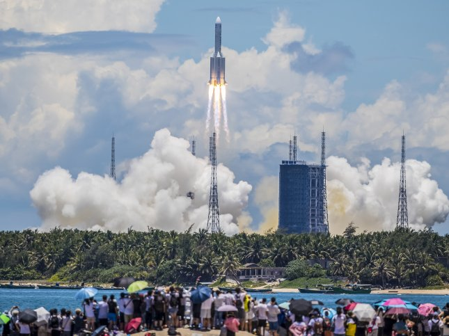 The rocket carrying China's Tianwen-1 Mars rover is seen after liftoff in Wenchang, Hainan province, China, on Thursday. Photo by EPA-EFE