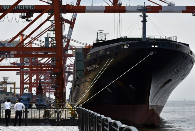 A container ship is loaded at the Aomi Container Terminal in Tokyo, Japan, in May. File Photo by Franck Robichon/European Pressphoto Agency