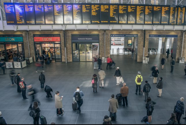 People inside King's Cross railway station near London Euston station, which had a signal failure Thursday, disrupting thousands of customers. File Photo by Alexandre Rotenberg/Shutterstock