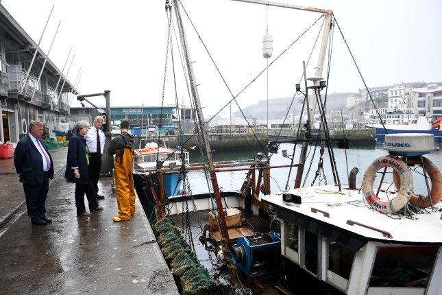 Britain's Prime Minister Theresa May meets fisherman Carl Hatton (R) in the Plymouth fisheries during a campaign even on May 31. On Monday, Britain will trigger a two-year process to withdraw fromm the London Fisheries Convention. Photo by Facundo Arrizabalaga/pool/EPA