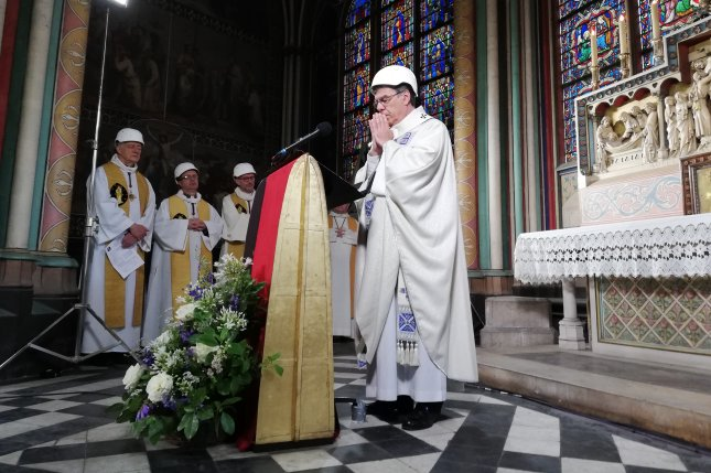 Clerics attend a mass Saturday led by Michel Aupetit (R), Archbishop of Paris, marking the first church service at Paris' Notre Dame cathedral since it was damaged by a devastating fire exactly two months earlier. Pool Photo by Karine Perret/EPA-EFE