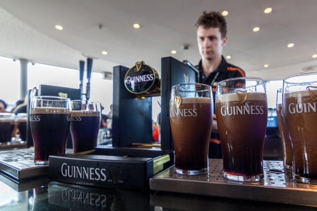 Visitors can enjoy a pint - or two - at the Guinness Storehouse in Dublin, Ireland. The company recently announced it will no longer be using fish bladders in the brewing process to make the beer more attractive to vegetarians and vegans. Photo by POM POM/Shutterstock
