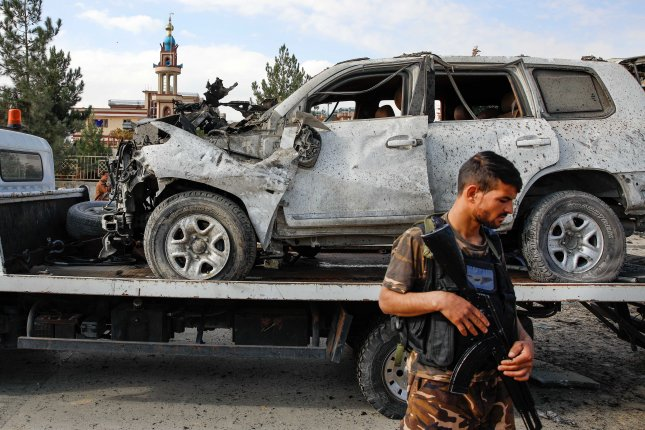 Armed Afghan security forces secure the site of a car bomb attack in Kabul on Wednesday. Photo by Hedayatullah Amid/EPA-EFE