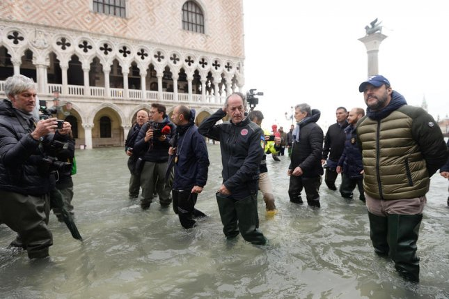 Italian League Party leader Matteo Salvini and Veneto Governor Luca Zaia walk in floodwaters in Venice on Friday. Photo by Andrea Merola/EPA-EFE
