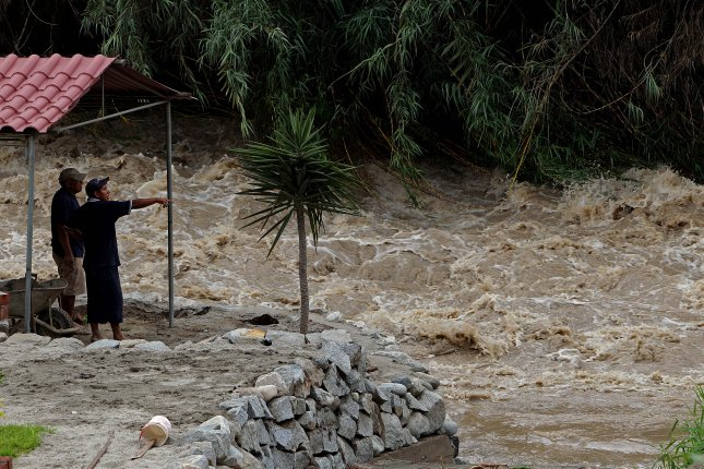 Water overflows the banks of the Santa Eulalia river in Tarazona, Chosica district, in Lima, Peru, on Thursday. Heavy rains have caused flooding in many parts of the country and left 62 dead. Photo by German Falcon/EPA