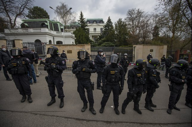 Riot police stand guard as people gather to protest in front of the Russian embassy in Prague, Czech Republic, on Sunday. Photo by Martin Divisek/EPA-EFE