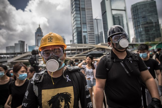 Protesters block a main road outside government buildings in Hong Kong, China, on Friday. Hong Kong is braced for new demonstrations as the government did not respond to a list of protester demands, such as a complete withdrawal of an extradition bill and investigation into police brutality. Photo by Roman Pilipey/EPA-EFE