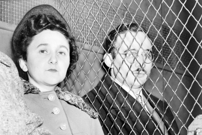 Ethel and Julius Rosenberg are pictured separated by a heavy wire screen as they leave the U.S. Court House after being found guilty of espionage by a jury on March 29, 1951. File Photo by Library of Congress/UPI