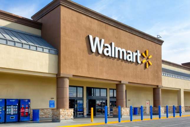 Walmart announced Wednesday it will raise the age restriction for purchase of firearms and ammunition to 21 and will remove nonlethal airsoft guns and toys and other items resembling assault-style rifles from its website. Photo by Ken Wolter/Shutterstock