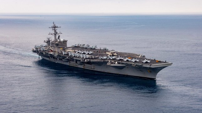 The Nimitz-class aircraft carrier USS Carl Vinson, pictured transiting the Pacific Ocean in July, entered the South China Sea today with its carrier strike group, according to the U.S. Navy. Photo by Mass Communication Specialist Seaman Isaiah Williams/U.S. Navy