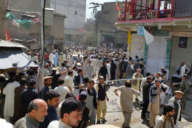 People survey the site of a bomb blast near a Shiite Mosque in the Noor marketplace in Parachinar, Pakistan, on Friday. At least 22 people died and up to 70 were injured in the bombing of which Jamaat-ul-Ahrar, a faction of the Pakistani Taliban, took credit. Photo by STR/EPA