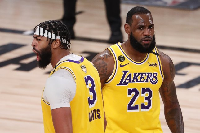 Los Angeles Lakers stars LeBron James (R) and Anthony Davis (L) react after scoring against the Miami Heat during the second half in Game 1 of the NBA Finals on Wednesday at the ESPN Wide World of Sports Complex near Orlando, Fla. Photo by Erik S. Lesser/EPA-EFE
