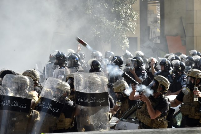 Riot police fire tear gas against anti-government protesters during a demonstration outside of the Lebanese Parliament in Beirut, Lebanon, on Saturday. Photo by Wael Hamzeh/EPA-EFE