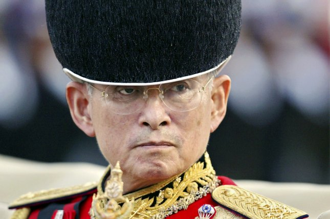 A file picture from 2004, shows Thai King Bhumibol Adulyadej inspecting the royal parade of honor in Bangkok. Bhumibol died Thursday and the nation's crown prince said he will not imediately ascend to the throne, leaving a caretaker monarch in place. File Photo by Vinai Dithajohn/epa