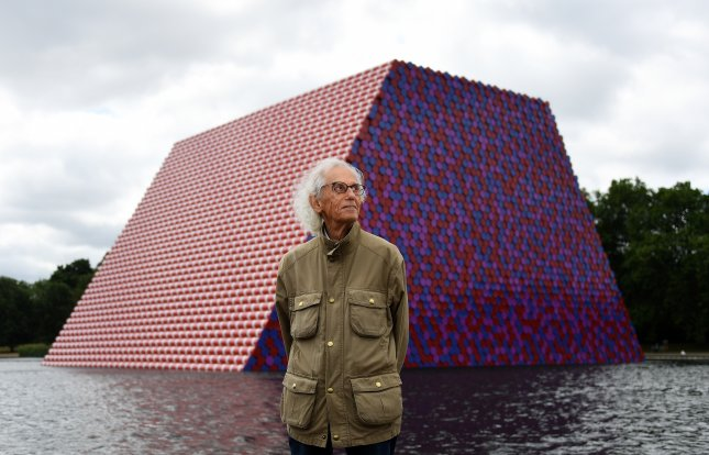 Bulgarian artist Christo stands in front of his artwork The London Mastaba built on the Serpentine Lake in London, Britain, on June 18, 2018. File Photo by Andy Rain/EPA-EFE