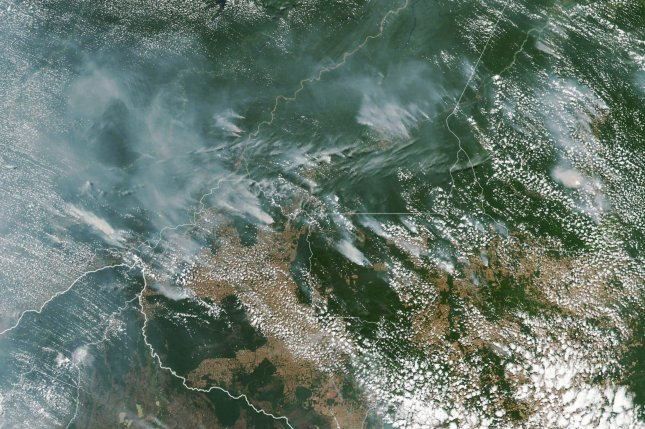 A NASA satellite image shows several fires burning in the Brazilian state of Amazonas. Photo courtesy of NASA Earth Observatory