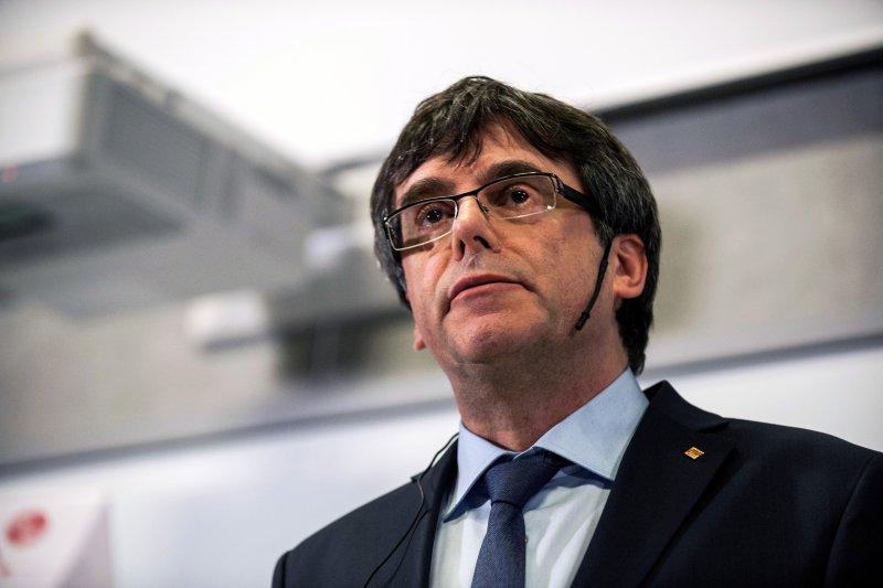Former Catalan President Carles Puigdemont speaks during a debate at the University of Copenhagen in Copenhagen, Denmark, on January 22, 2018. File Photo by Ricardo Ramirez/EPA-EFE