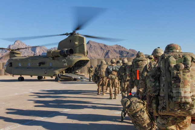 Soldiers of the 101st Resolute Support Sustainment Brigade board a Chinook helicopter to conduct missions across the Combined Joint Operations Area- Afghanistan. UPI Photo/File