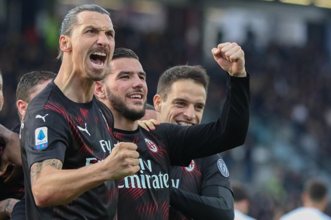AC Milan's Zlatan Ibrahimovic (L) now has 50 career goals for the Italian soccer squad after he scored twice Wednesday in Genoa, Italy. Photo by Fabio Murru/EPA-EFE