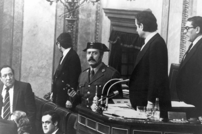 Col. Antonio Tejero Molina attempts a coup d'état before Spanish Parliament during a vote for a new premier on February 23, 1981. File Photo by Hugo Peralta/UPI
