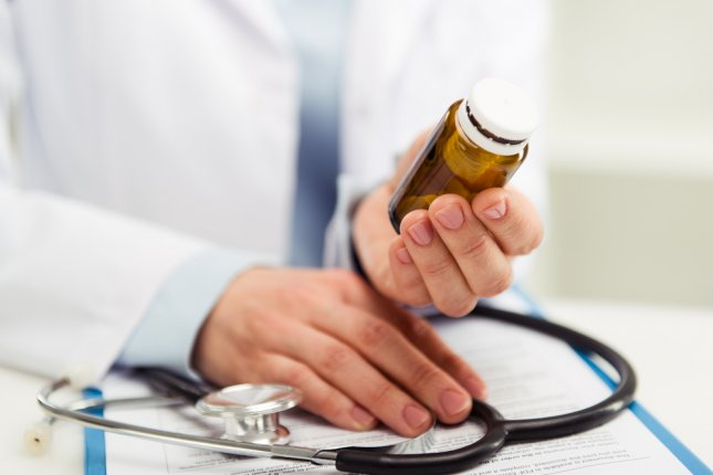 Researchers examined more than 63,000 physicians who took payments to promote opioid drugs, comparing them to more 800,000 physicians who did not -- finding prescriptions go up when payments do. Photo by Tasique/Shutterstock