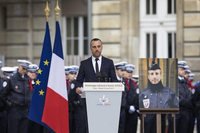Etienne Cardiles delivers a speech during a ceremony for his partner, police officer Xavier Jugele, at the Paris police headquarters on April 24. They were married in a posthumous ceremony Tuesday. Jugele was killed by a militant gunman on the Champs Elysees. File Photo by Ian Langsdon/EPA
