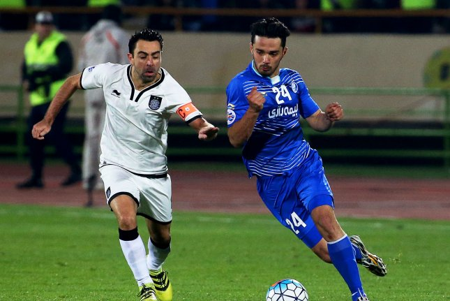 Esteghlal's Omid Nourafkan (R) in action against Al Sadd's Xavi Hernandez (L) during the 2017 AFC Champions League play-off soccer match between Esteghlal FC and Al Sadd SC on February 7 at the Azadi Stadium in Tehran, Iran. File Photo by Stringer/EPA