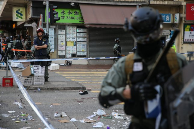 Police guard an area where a protester was shot in Hong Kong on Monday. Photo by Jerome Favre/EPA-EFE