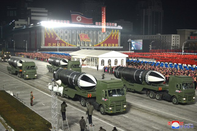 A photo released by the official North Korean Central News Agency shows a new type of submarine-launched ballistic missile during a military parade on January 14. Photo courtesy of KCNA/EPA-EFE