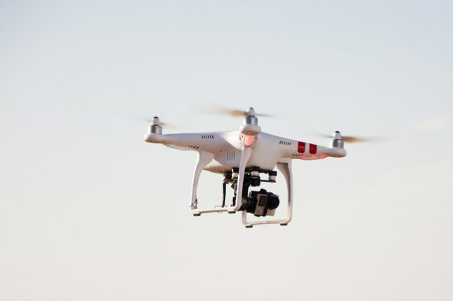 Quadcopter drone with mounted camera. Photo by Newnow/Shutterstock