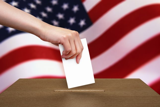A ballot is cast. This voter would have the right to a selfie with their ballot, if they live in Indiana. Photo by Peeradach Rattanakoses/Shutterstock.com