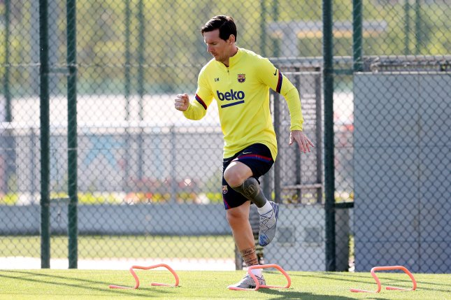 Liverpool manager Jurgen Klopp said Lionel Messi's (pictured) ability to succeed despite his small physical stature make him a better player than Cristiano Ronaldo. Photo courtesy of FC Barcelona/Miguel Ruiz/EPA-EFE