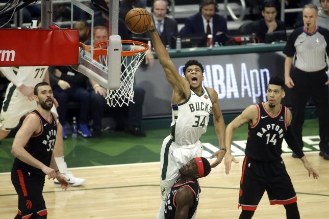 Milwaukee Bucks forward Giannis Antetokounmpo (34) dunks over Toronto Raptors forward Pascal Siakam during Game 2 of the NBA Eastern Conference finals on Friday night at Fiserv Forum in Milwaukee, Wisconsin. Photo by Aaron Gash/EPA-EFE