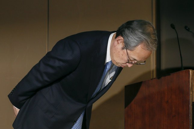 Satoshi Tsunakawa, president and CEO of Toshiba Corp., bows at the start of a news conference Tuesday in Tokyo. Toshiba had delayed the release of its quarterly earnings dueand finally released them without approval from their auditors. Photo by Kimimasa Mayama/EPA