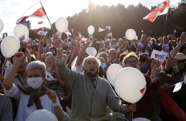 People attend a campaign rally of Belarusian opposition presidential candidate Svetlana Tikhanovskaya on Thursday as authorities said they arrested 33 alleged Russian mercenaries suspected of attempting to interfere with the nation's elections. Photo by Tatyana Zenkovich/EPA-EFE