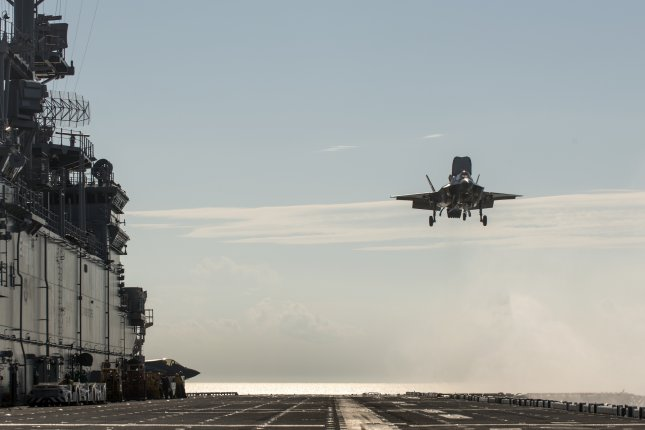 An F-35B test aircraft prepares to land vertically on the deck of the USS Wasp Aug. 22, 2013. The aircraft was flying during F-35 short takeoff/vertical landing Developmental Test Phase Two. Photo courtesy of Lockheed Martin